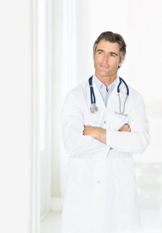 contemplative-male-doctor-looking-at-copyspace-in-corridor-xs