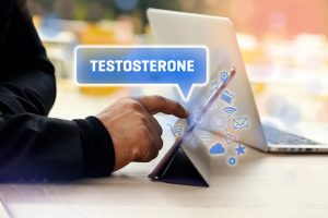 Pointing at testosterone symbol on laptop 300x200