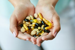 handful of vitamin pills 300x200