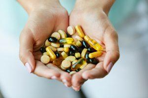 handful of vitamin pills 300x200