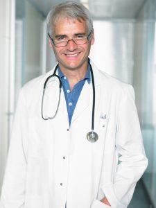 HGH Doc wearing blue shirt 225x300