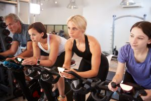 group of exercisers in bicycle class 300x200