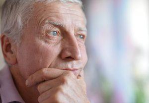 Unhappy senior man 300x208