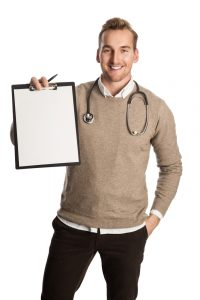 a handsome testosterone surgeon with a stethoscope around his neck holding a clipboard and smiling  200x300